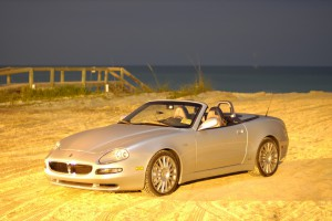 2002 Maserati Spyder on the brilliant, fine Florida sand with an Atlantic Ocean backdrop.